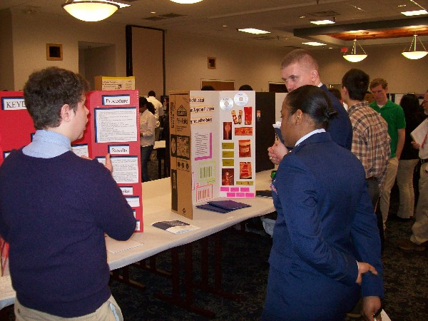 Chapter judges Lt. Salandy and Capt. Wachlin examine a contestant�s entry during the Tidewater Science and Engineering Fair in March.
