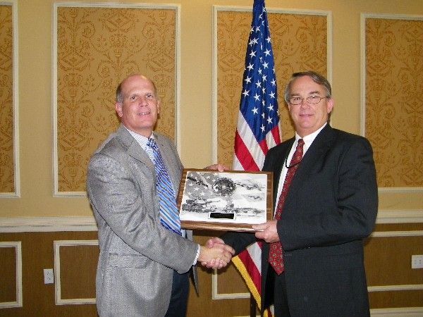 Ken Hirlinger, chapter president (l), congratulates Mark Peterson for his selection as the May AFCEAN of the Month recipient. Peterson was the point person for organizing support for the East: Joint Warfighting 2013 conference.