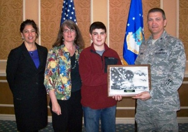 In March, Col. Powell presents Tristan Gerth (2nd from r) with a chapter plaque while Terry Guthrie (l), Tabb Science Department chair, and Tristan�s mother Pam look on. Tristan, an 8th grader from Tabb Middle School, received the Young AFCEAN of the Month Award for February recognizing his keen interest and perseverance in researching and testing alternative energy sources using the AFCEA-funded Wind Generator and Fuel Cell.
