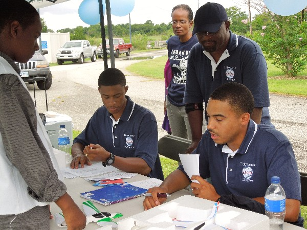 Chapter volunteer judges Corey Kinsler, Braxton Ward and William Benson question a Hampton Middle School student in April on the journal maintained in preparation for the UAV competition.
