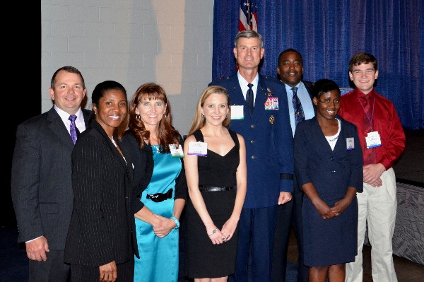 The chapter awarded $13,500 in scholarships to local students. Brig. Gen. David Uhrich, USAF, ACC/A-6, greets three of the recipients and their parents at the East: Joint Warfighting 2013 conference in May in Virginia Beach, Virginia. From left,