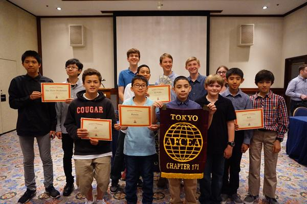 Winners of the Kanto Plains Robot Rumble receive scholarships and certificates from the chapter at an April meeting.