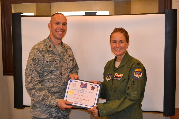 Chapter President Maj. Chad Richardson, USAF presents a certificate of appreciation to Col. Bobbi Doorenbos, USAF, commander of the 214th Reconnaissance Group, following her address to the Chapter on MQ-1 Predator operations and reliance on a distributed communications architecture in September.