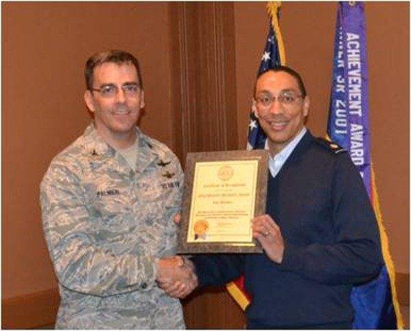 Col. Palmieri (l) presents an AFCEA Life Member certificate and pin to Maj. Brian Sroufe, USAF, commander, 355th Communications Squadron, during the February chapter luncheon.