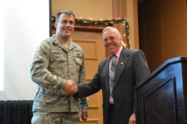 Larry Bingaman (r), regional vice president, presents the AFCEA coin for Outstanding Service to Col. Dick Palmieri, USAF, for his dedication in developing Young AFCEANs. The chapter has both a chapter and regional distinguished Young AFCEAN this year for the first time in its history.