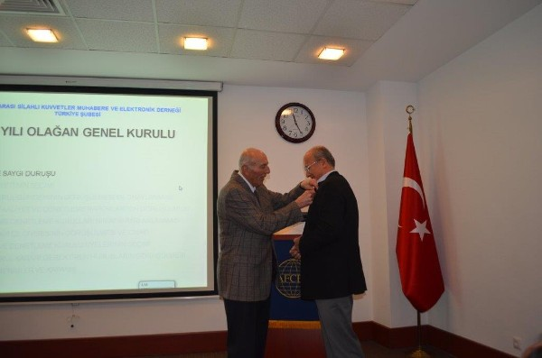 In January, Col. I. Bora Buyukoner, TUA (Retd.), chapter president, presents a 25-year membership pin to Ugur Karavelioglu, who has been a member of AFCEA since September 19, 1988.