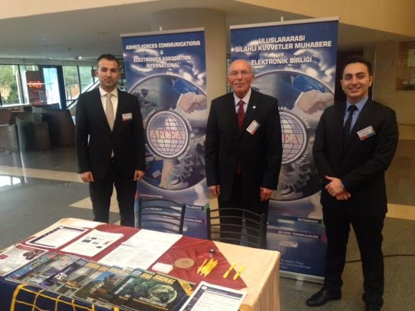 (l-r) M. Yasar Ercan, chapter member, Col. I. Bora Buyukoner, TUA (Ret.) and chapter president and Seyfettin Sunger, chapter member, pose at the chapter booth during the 4th Military Electronics Systems Seminar and Exposition in January.
