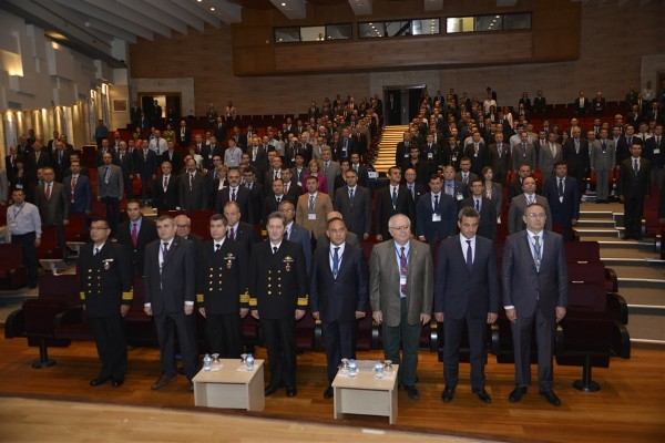 (4th f-l front row) Rear Adm. O. Mesut Ak, TUN, chief of technical division of Turkish Naval Command, (5th f-l) Mujdat Uludag, head of Naval platforms, Department of SSM, (3rd f-l) Capt. Mustafa Murat, TUN, chief of ship building division of TNC, (6th f-l) Dr. Kemal Leblebicioglu, instructor, METU-EEE, (8th f-l) Mustafa Kaval, vice president of ASELSAN and the other participants stand for the National Anthem of Turkish Republic during the opening ceremony of the seminar in October.