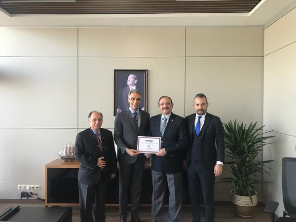 In February, Chapter President Kamil Zafer Selcuk (center r) presents a certificate of appreciation to Selcuk Kerem Alparsan, general manager of Turkish defense technology company Meteksan Savunma (center l).