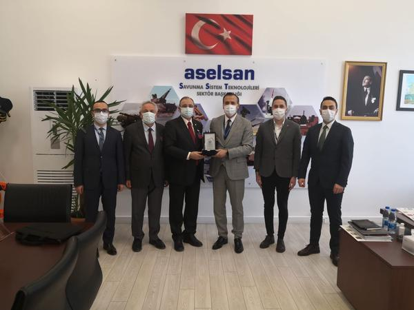 (From l-r) Zekeriyya Sahin, director, SST Electronics and Software Design, ASELSAN; Erdinc Oguz; Kamil Zafer Selcuk, chapter president; Behcet Karatas, deputy general manager, ASELSAN, and sector president, DST; Serhat Hilmi Bizimtuna; and Seyfettin Sunger met in February at the offices of corporate member ASELSAN.