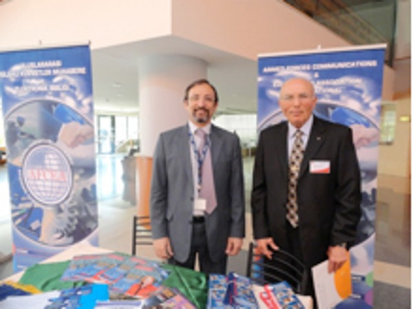 Capt. K. Zafer Selcuk, TUN (Ret.) (l), chapter secretary, and Col. I. Bora Buyukoner, TUA (Ret.), chapter president, manage the chapter's exhibit at the TAI 6th Aviation and Avionics Systems Seminar and Exposition in May.