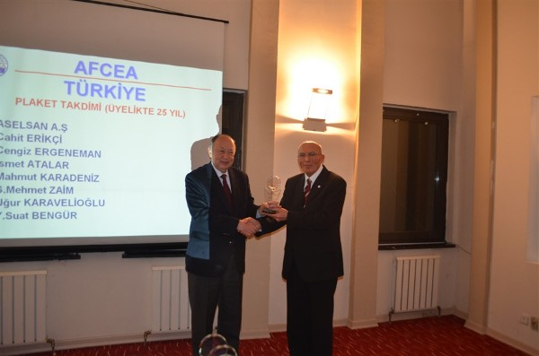 At the December event, Col. Buyukoner (r) presents a plaque to Cengiz Ergeneman, who has been an individual member of AFCEA since September 19, 1988.