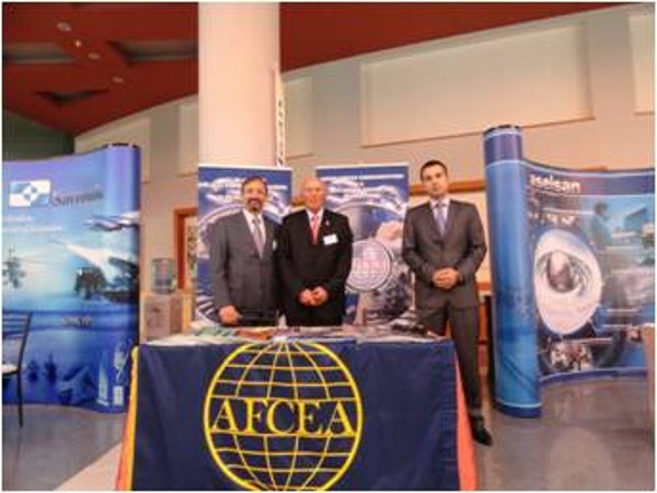 Managing the chapter's booth at the September exhibition are (l-r) Capt. K. Zafer Selcuk, TUN (Ret.), chapter secretary; Col. Buyukoner; and M. Yasar Ercan, chapter board of directors.