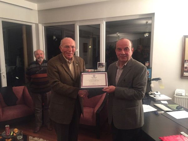 Col. Buyukoner presents a certificate of appreciation to guest speaker Karadeniz at the January event.