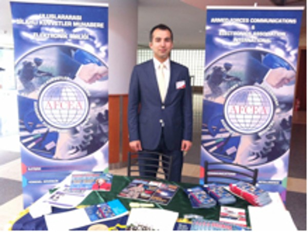 M. Yasar Ercan, chapter Young AFCEAN adviser and board member responsible for events and activities, oversees the chapter's exhibit in May.