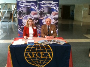 Promoting AFCEA at the chapter's exhibit in March are Esra Erkan (l), chapter board member, and Col. I. Bora Buyukoner, TUA (Ret.), chapter president.