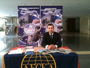 M. Yasar Ercan, chapter board member and Young AFCEAN adviser, assists at the chapter's exhibit in March.