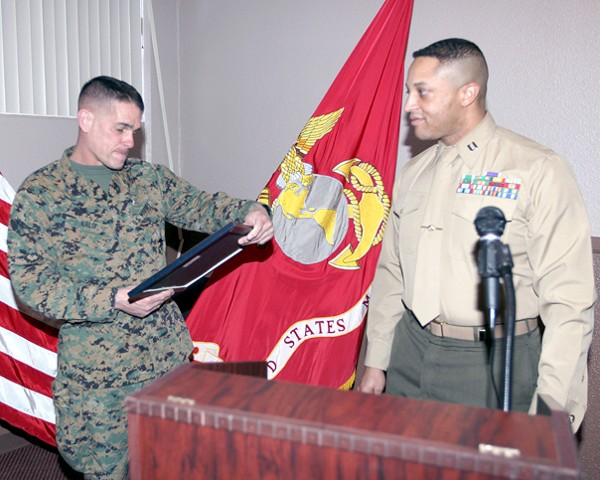 Capt. Marc N. Shelton, USMC (r), chapter president, presents Brig. Gen. Kevin J. Nally, USMC, director, command, control, communications and computers, and chief information officer of the Marine Corps, with a token of appreciation for his highly informative brief at the February luncheon.
