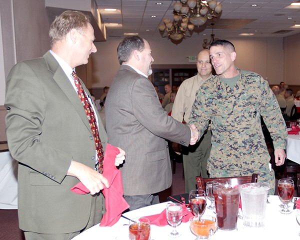 Gen. Nally greets industry representatives who attended the February luncheon.