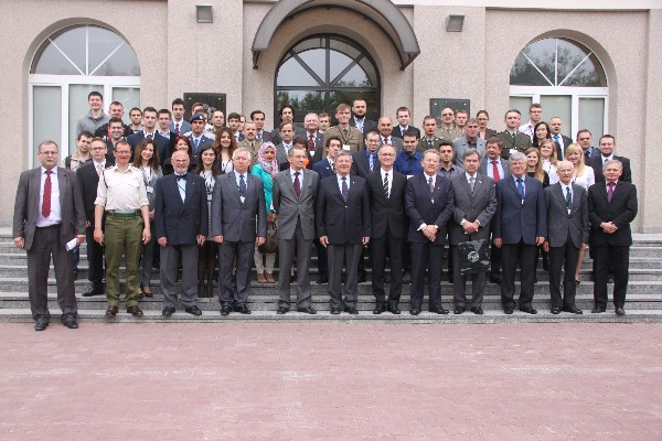 Delegates from the International Electronic Telecommunication Conference of Students and Young Scientists join members of the Scientific Committee outside of the Military University of Technology conference center in May.