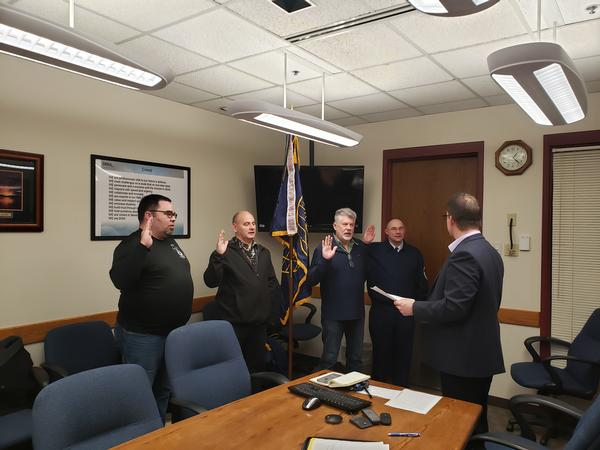 At the December meeting, additional board members (l-r) Chris Flohaug, vice president of scholarships; Woehl, chapter vice president; Scott Warren, vice president of programs; and Senior Master Sgt. William Ceglar, vice president, Military Affairs, are sworn in.
