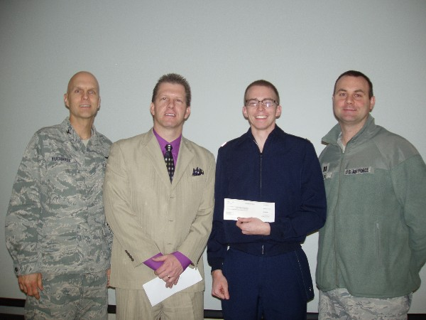 In January, Cadet Charles Connors, Air Force ROTC (2nd from r), Detachment 855, Brigham Young University, receives a scholarship from Col. Paul Kucharek, USAF (l), commander; Capt. Richard Hart, USAF, recruiting flight commander; and Martin.