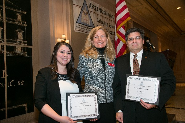 Lisa Nowell (c), chapter president, recognizes February award recipients: Young AFCEAN of the Month Kate Friesing, field account manager for Citrix Systems Incorporated, and AFCEAN of the Month Randy Clark, vice president of strategic programs for Oceus Networks.
