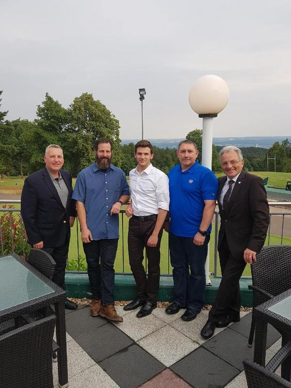 Maj. Gen. Erich Staudacher, GEAF (Ret.), general manager of AFCEA Europe (r), gathers with the chapter's newly elected officers, including David Pendall, president (l), at the membership kickoff event in July.