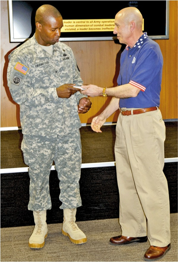 H.S. Schmidt, chapter president, presents guest speaker Brig. Gen. Bruce Crawford, USA, 5th Signal commander, with a token of appreciation at the April meeting.